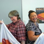 Two womening laughing while working bring well-being to both and makes the wokload lighter.