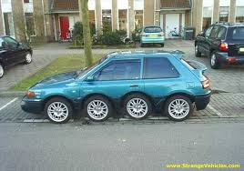 Photo of a car with 8 wheels live your values