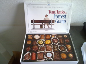 Image of chocolate box and poster for forrest gump movie with tom hanks