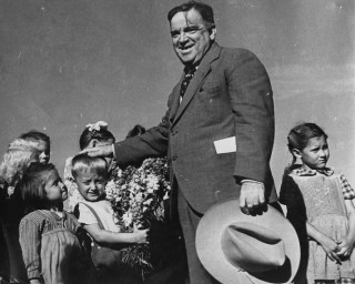 Mayor LaGuardia talks with children displaced by World War II